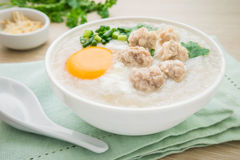 Congee with minced pork and boiled egg in bowl stock image