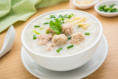 Congee with minced pork in bowl. Congee with minced pork in white bowl Stock Photos