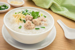 Congee with minced pork in bowl royalty free stock photos