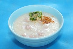 Congee. With pork and egg Stock Image