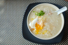 Congee with egg. Congee with pork and egg and vegetable on morning Royalty Free Stock Image