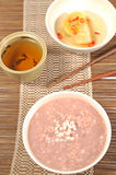 Congee red rice and tea Stock Images