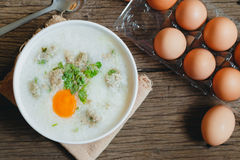 Congee. Rice gruel Khao Tom Moo mixed with pork and eggs Stock Photography