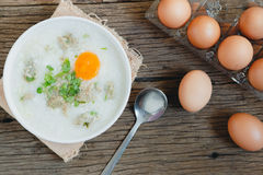 Congee. Rice gruel Khao Tom Moo mixed with pork and eggs Stock Photos