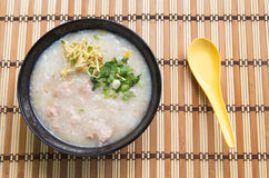 Congee, Rice porridge, Rice gruel, Rice soup on wooden background, Top view.  Stock Photos