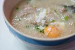Congee Rice Porridge with Soft-boiled eggs. royalty free stock photography