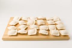 Congelado bolinhas de massa em uma placa foto de stock royalty free