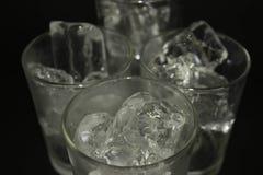 Congele em um vidro em um fundo preto Fotos de Stock Royalty Free