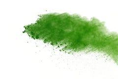 Congele o movimento do pó verde que explode no fundo branco fotografia de stock