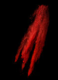 Congeli il moto dell'esplosione di polvere rossa isolata sopra Fotografia Stock Libera da Diritti