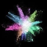 Congeli il moto delle esplosioni di polvere colorate sul nero Fotografia Stock