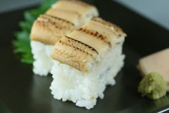 Conger eel sushi. With wasabi and sliced ginger Stock Photo