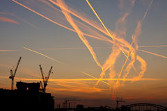 Congested Airspace at Sunrise. Contrails crossing each other. Congested airspace over Frankfurt, Germany, at sunrise Royalty Free Stock Photos