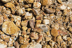 Conglomerate iron stained rock wall background Royalty Free Stock Photography