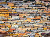 Conglomerate rock fence wall pattern Stock Image
