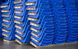 Conglomeration of blue plastic seats Royalty Free Stock Photo