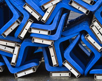 Conglomeration of blue plastic seats Stock Image