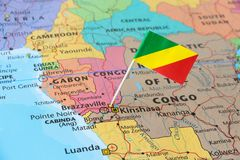 Congo flag pin on map. Congo paper flag pin on a country map. The Republic of the Congo, also known as Congo-Brazzaville, the Congo Republic or simply Congo, is royalty free stock images