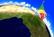 Congo Republic national flag marking the country location on world map. 3D render of the world with the location of the country of Congo Republic marked by its Stock Images