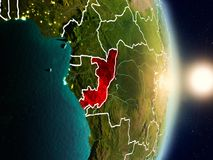 Congo during sunrise. Highlighted in red on planet Earth with visible country borders. 3D illustration. Elements of this image furnished by NASA Royalty Free Stock Photos