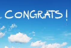 Congrats! написанный в небе Стоковое Изображение RF