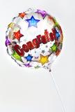 Congrats Balloon. A 'Congratulations' balloon over a plain background royalty free stock image