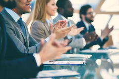 Congrats. Hands of business partners applauding to reporter after listening to presentation at seminar royalty free stock photos