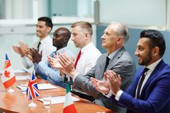 Congrats of leaders. Satisfied leaders of several countries clapping their hands after report of colleague royalty free stock photography