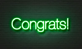 Congrats neon sign on brick wall background. Congrats neon sign on brick wall background royalty free stock photography