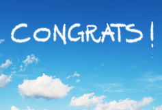 Congrats! written in the sky. With contrails royalty free stock image