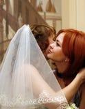 Congratulates. The girlfriend congratulates the bride Royalty Free Stock Images