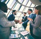 Congratulating colleagues Stock Photography