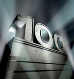 Congratulation 100. Number hundred in silver letters on a silver pedestal Stock Photos