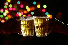 Congratulation. Two glasses of beer in colorful light Royalty Free Stock Photography