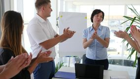 Congratulation and applause of working team in boardroom on background large windows stock footage