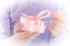 Congratulation! Boy open a gift in a pink box Royalty Free Stock Image