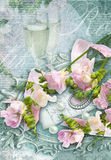 Congratulation card with champagne glasses, freesias and perls. Royalty Free Stock Images
