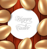 Congratulation card with Easter golden glossy eggs on wooden bac Royalty Free Stock Photography