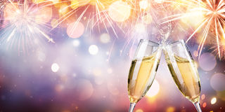 Congratulation With Champagne - Toast With Flutes. And Fireworks stock photo