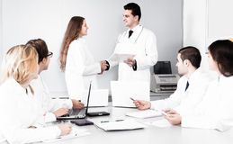 Congratulation of female doctor. Congratulation of female young doctor Stock Photo