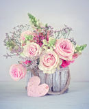 Congratulation with a flowers. Close-up floral composition with a pink roses .Beautiful bouquet for a birthday or Valentine`s Day.Congratulation with a flowers Stock Images