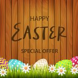 Congratulation with a happy Easter on a background of boards. Pa Royalty Free Stock Photo