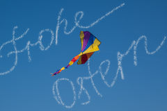 Congratulation Happy Easter of clouds in German with air kite in bright blue sky Stock Image