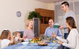 Congratulation heartily family at home Stock Photos
