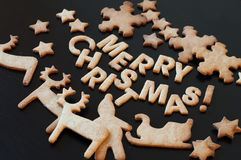 Congratulation with Merry Christmas from Gingerbread Cookies Royalty Free Stock Photo