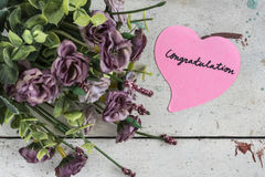 Congratulation note in heart shape paper with purple bouque Stock Photo