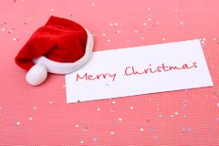 Congratulation from santa. Cap santa on cards with a congratulation of merry Christmas Stock Image