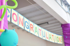 Congratulation sign hang tracking Stock Photos