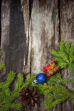 Congratulation to Christmas. On  planks background with fir branches Stock Photography