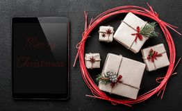 Congratulation for winter holidays, black ipad to write a message for your loved ones. Congratulation for winter holidays, black ipad to write a message for stock images